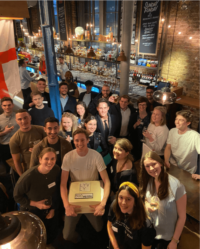 group of people posing to picture during the party in the pub