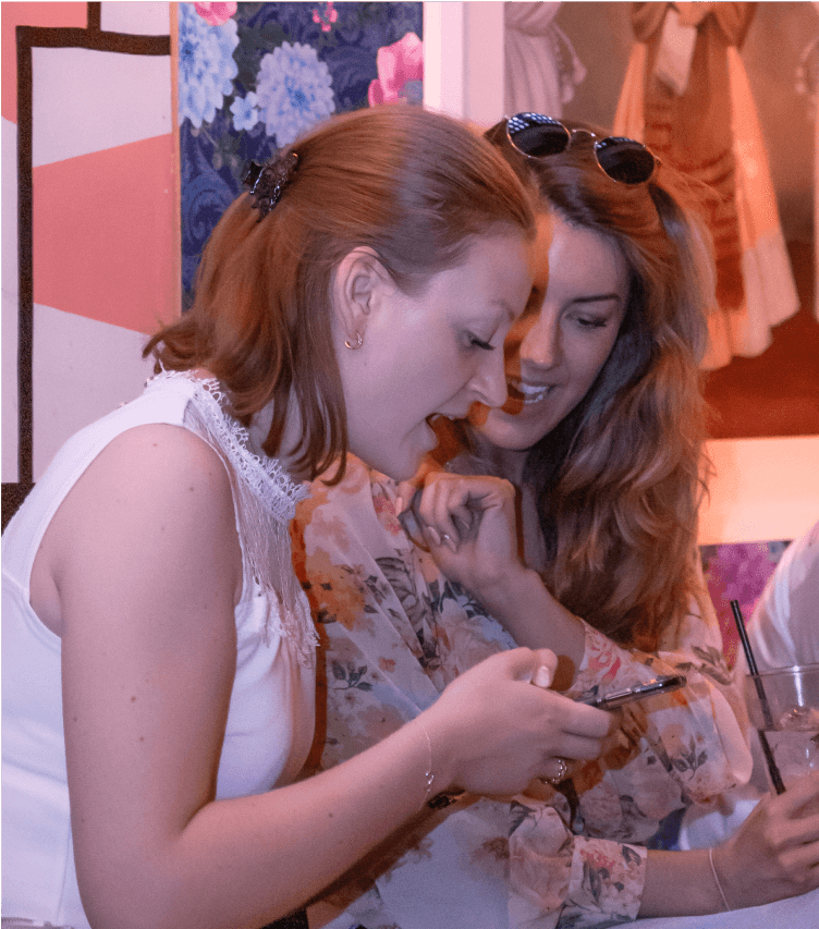 girls looking at the phone