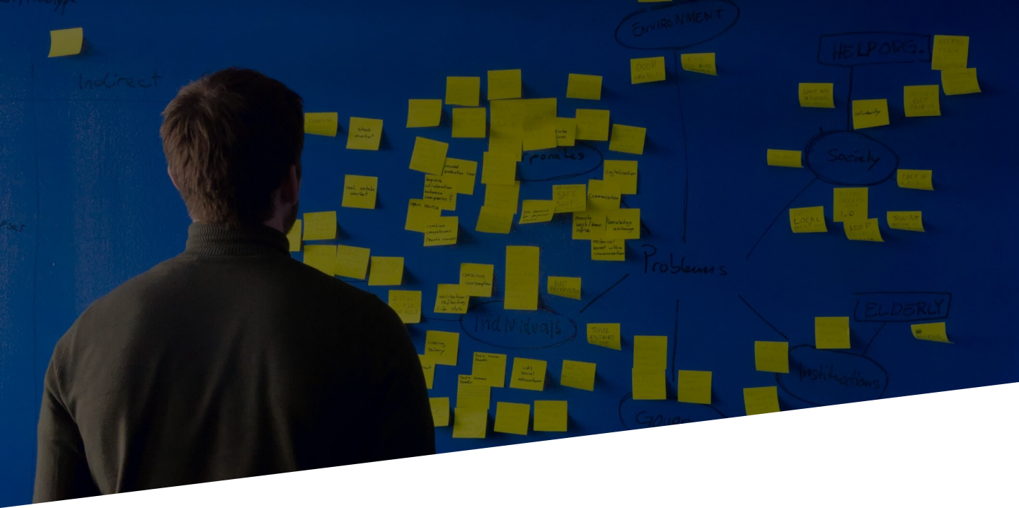Guy facing the wall with post it notes