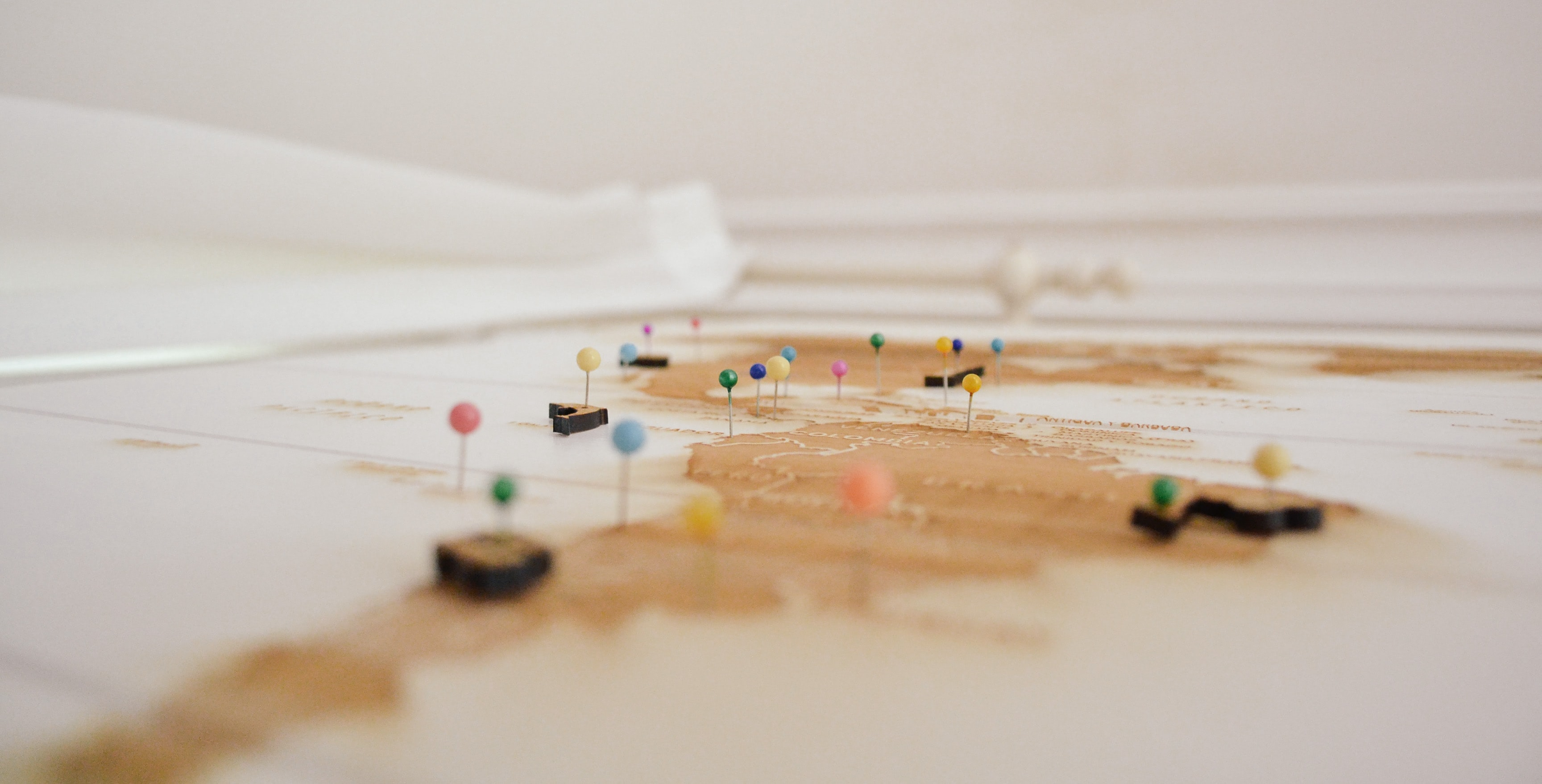 closeup of a map with push pins marking locations