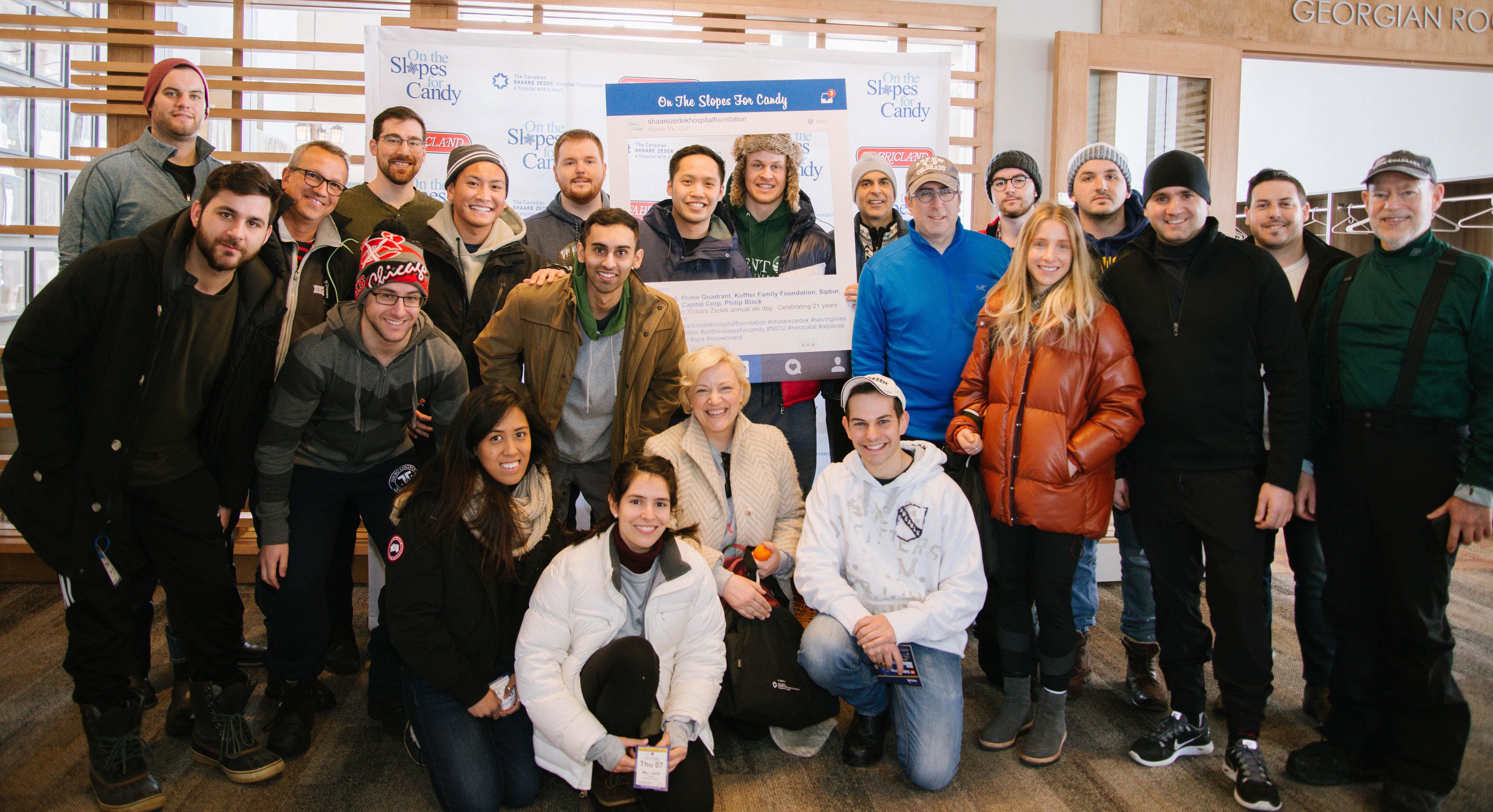 Prime Quadrant team members posing at a ski resort for the Shaare Zedek Hospital Foundation