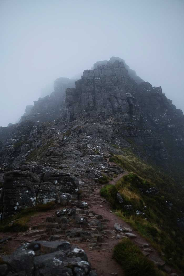 A misty photo of Stac Pollaidh in the Scottish Highlands