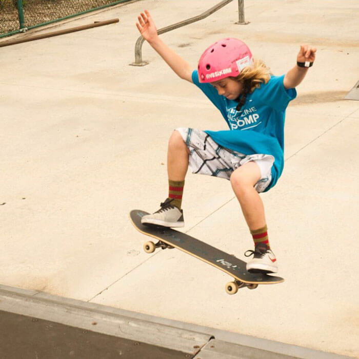 A shot of a young skateboarding competing in the Daily Adrenaline Annual Skate Competition while wearing the contest shirt