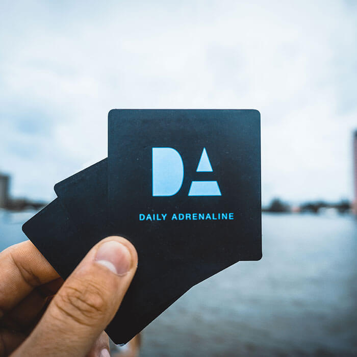 Daily Adrenaline product design showing the company logo on a square business card