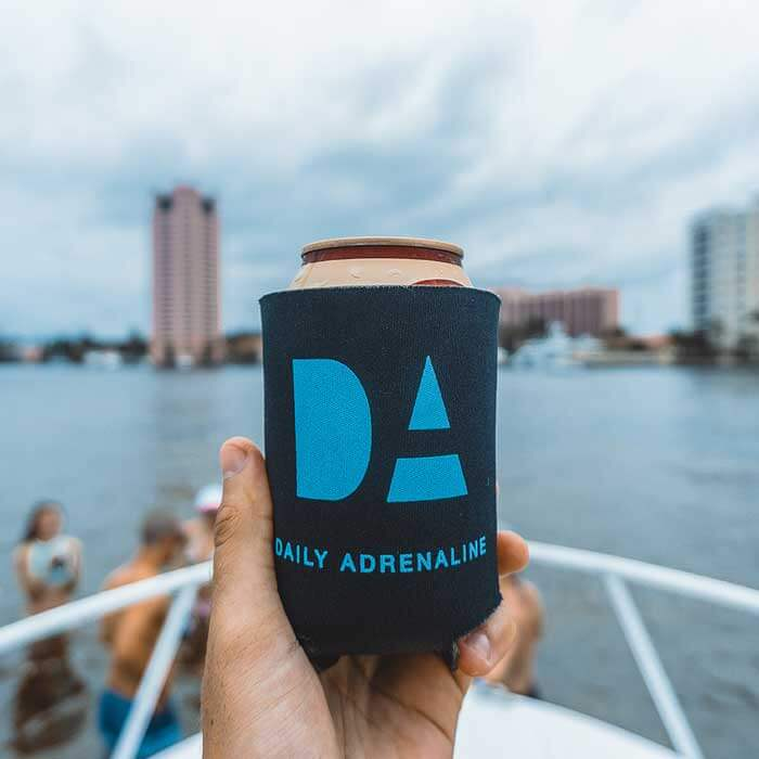 Daily Adrenaline product design showing the company logo on a beer koozie
