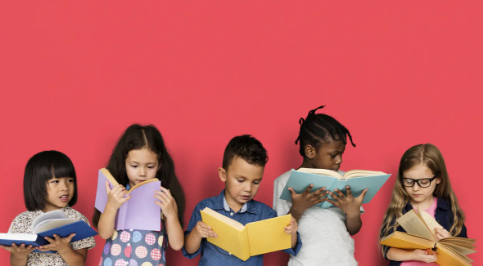 Children reading book with red background