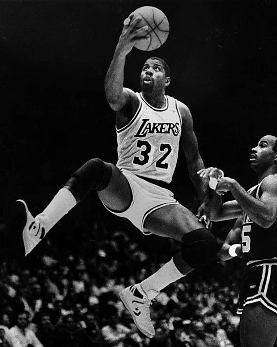 Magic Johnson playing basketball for LA Lakers