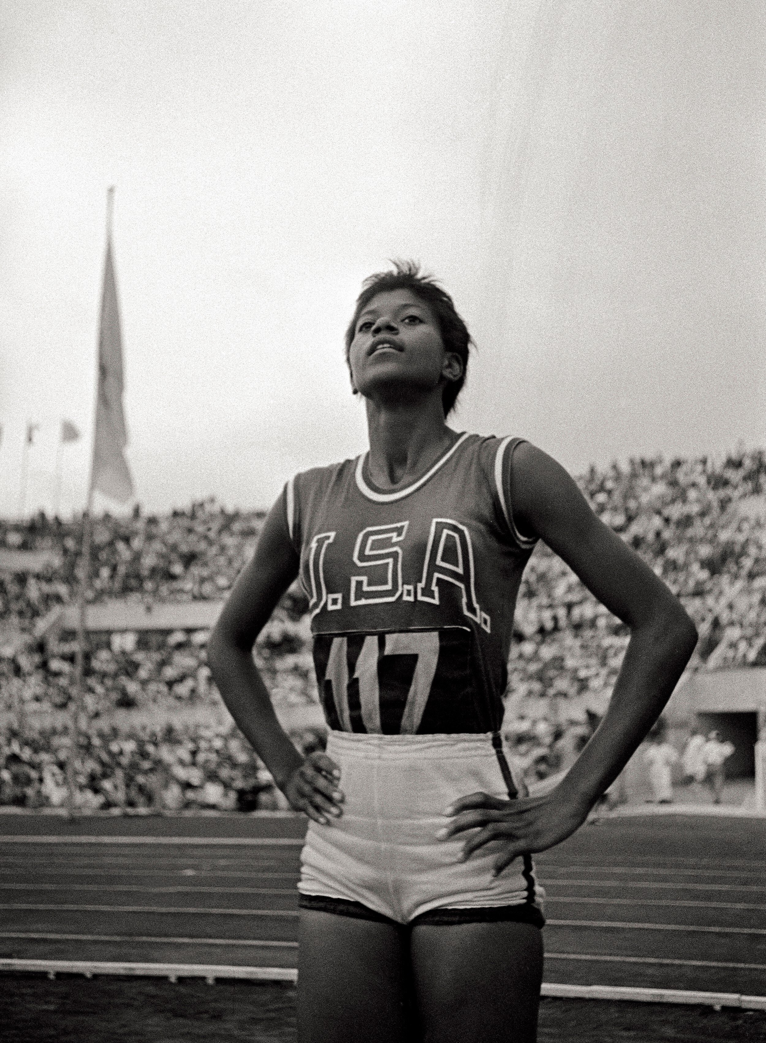 Wilma Rudolph standing with hands on hips