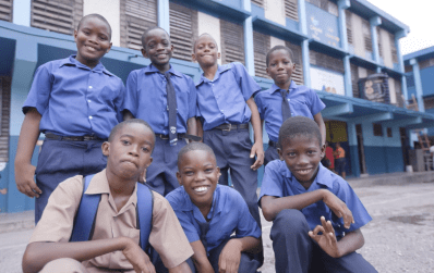 Shot of school kids smiling in their uniforms