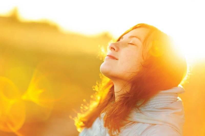 Woman enjoying the sunshine, feeling happy