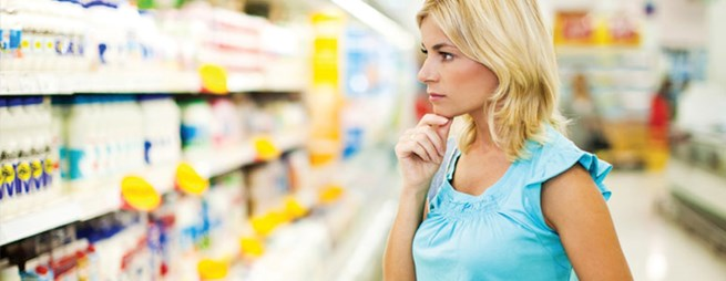 Woman browsing products in a supermarket