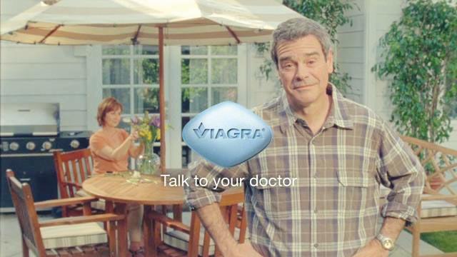 Man standing in backyard with Viagra logo overlay