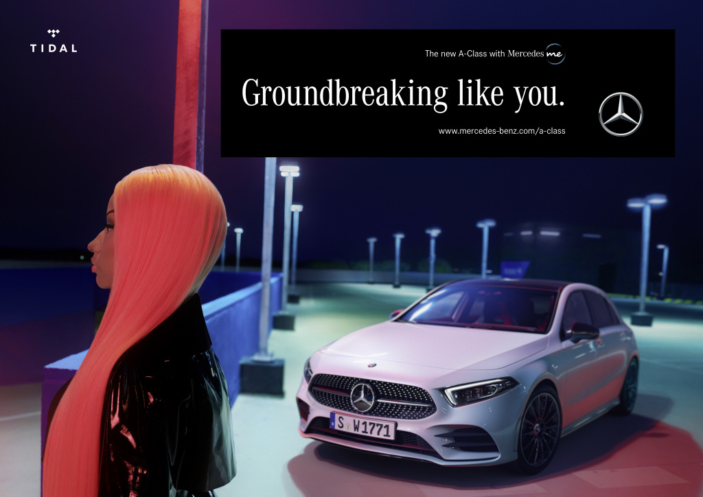 A woman with bright red hair stands in front of a Mercedes