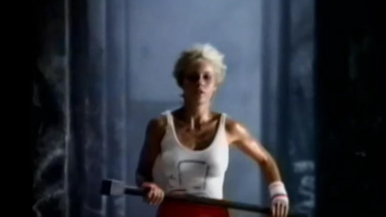 A female Olympian runs wielding a hammer