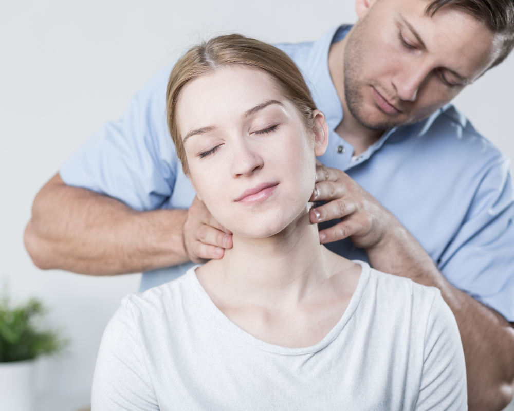 Woman finding relief from neck pain