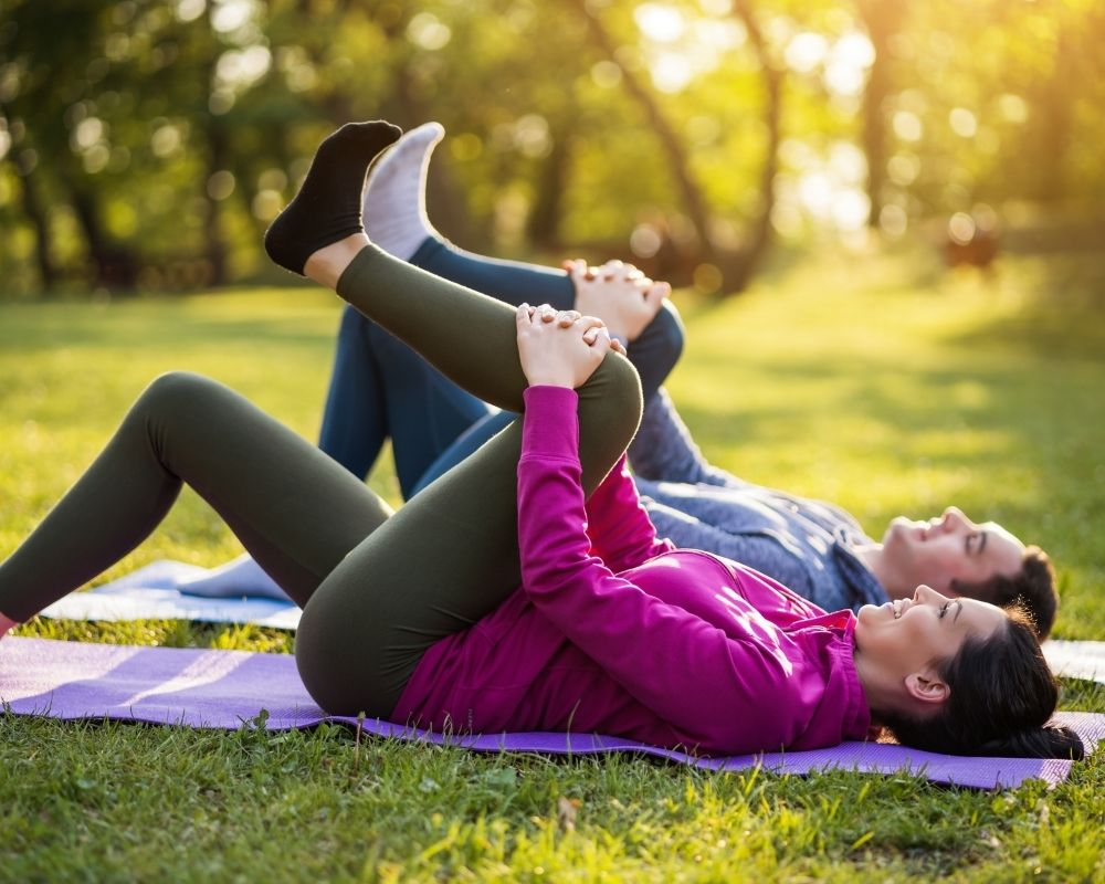 A couple doing leg stretches