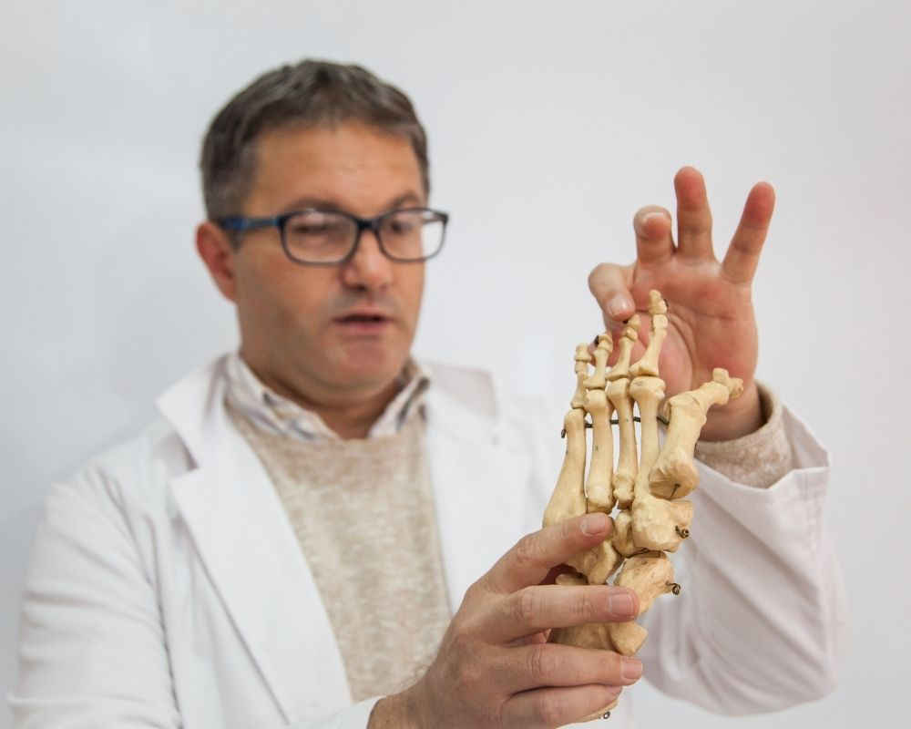 Pain management provider showing arthritis in hands