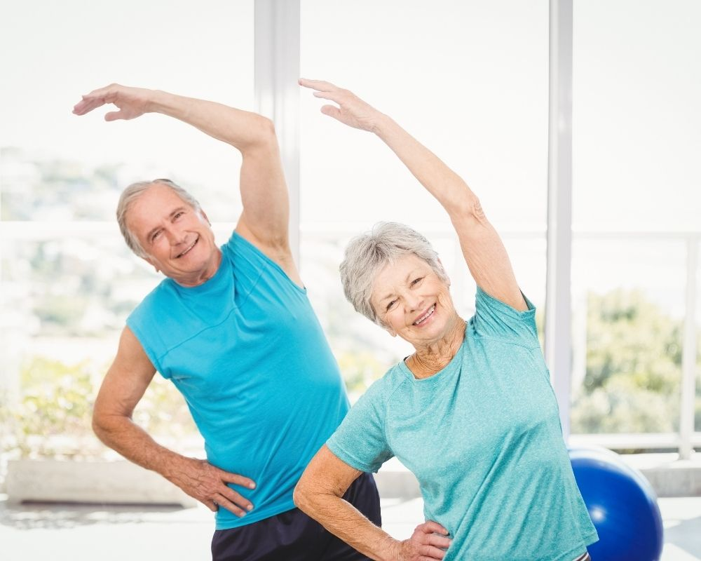 Old couple stretching and exercising