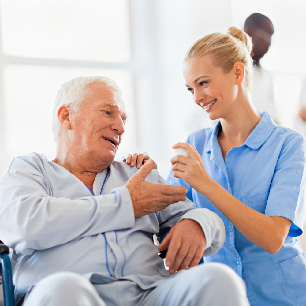 Cute nurse assisting older man find relief for his pain