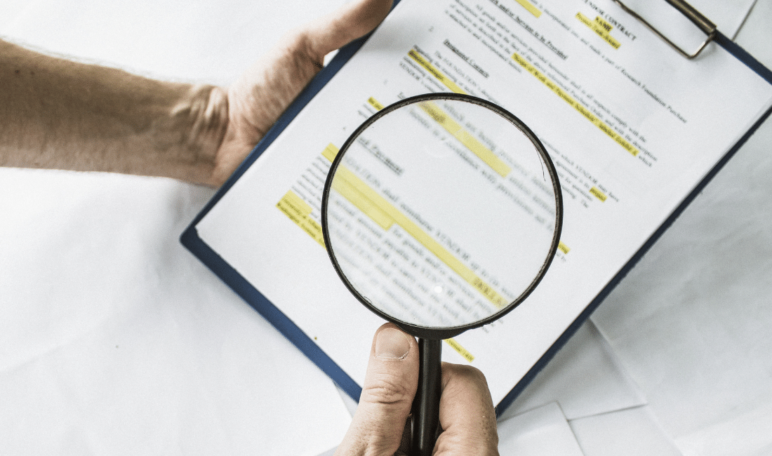 checking the fine print on business contract