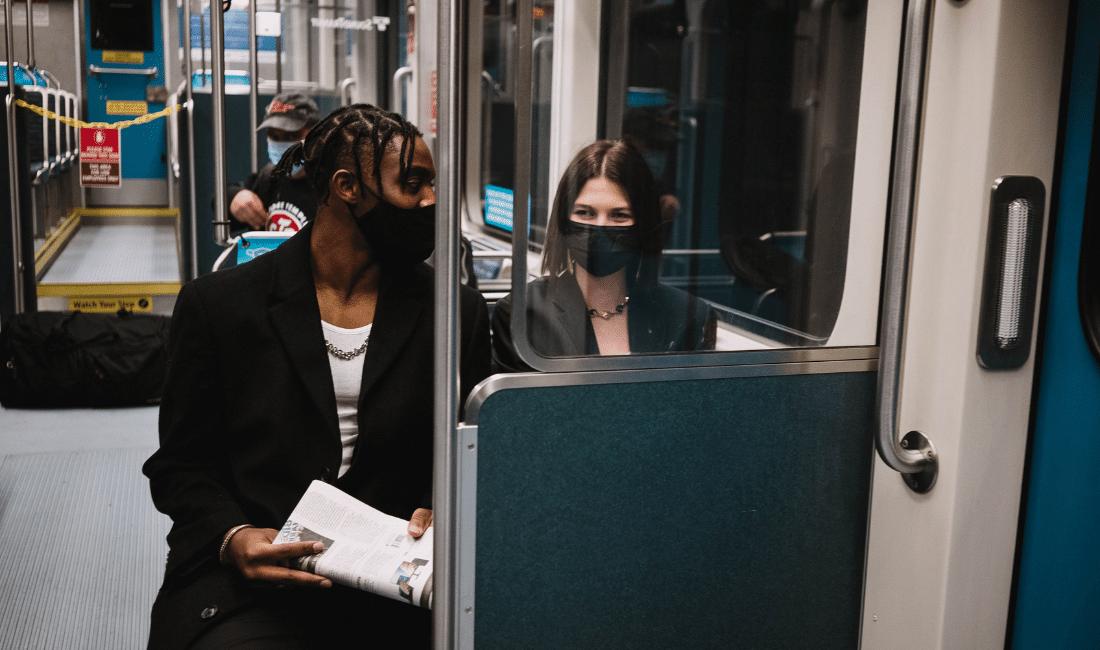 Man in Black Suit Jacket Sitting on Train Seat