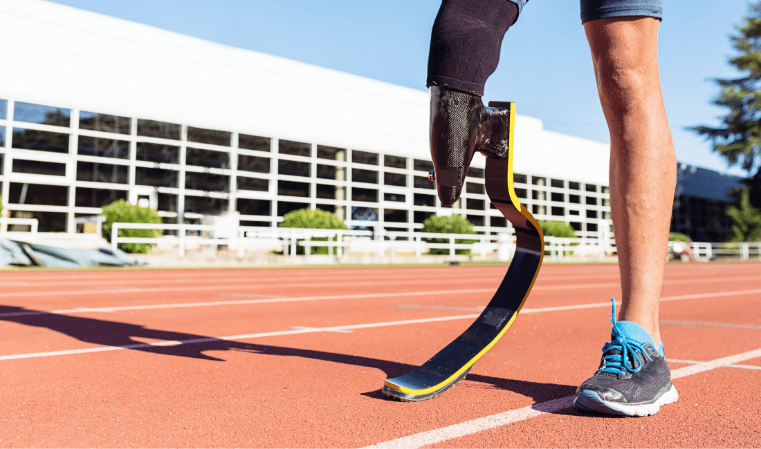 Close up disabled man athlete with leg prosthesis.