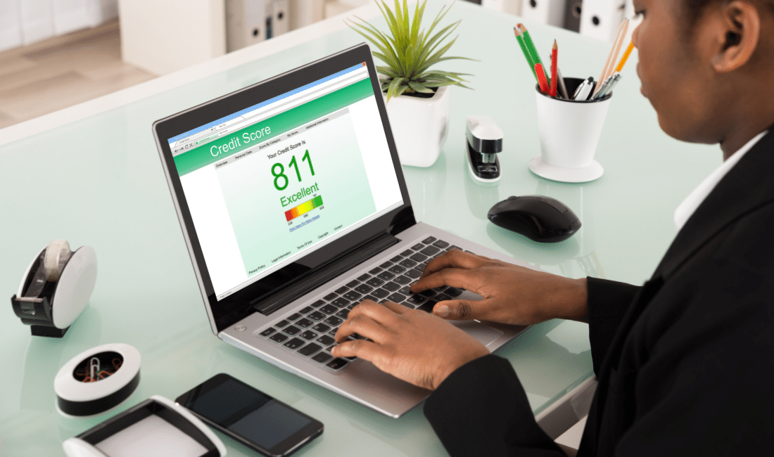 Businesswoman Checking Credit Score On Laptop
