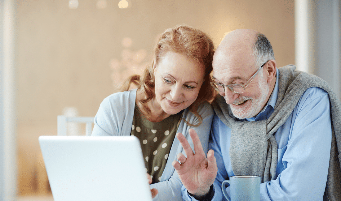 old Couple waving to a laptop.