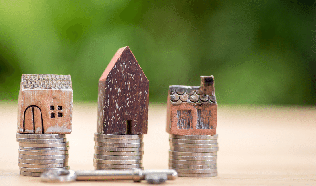 small Houses on top of coins