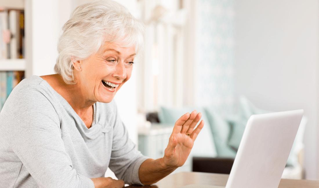 Senior lady video chatting on laptop