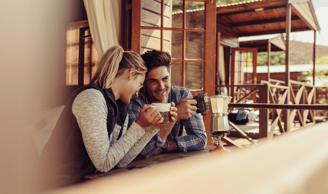Two couple drinking coffee at a cafe
