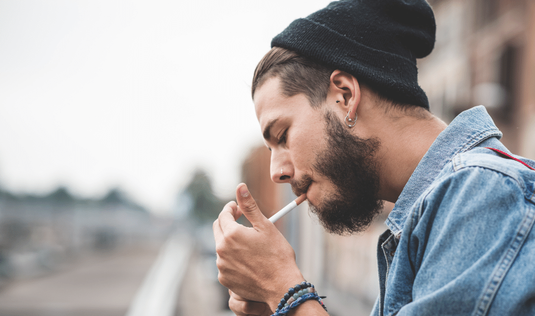Young guy smoking a cigarette
