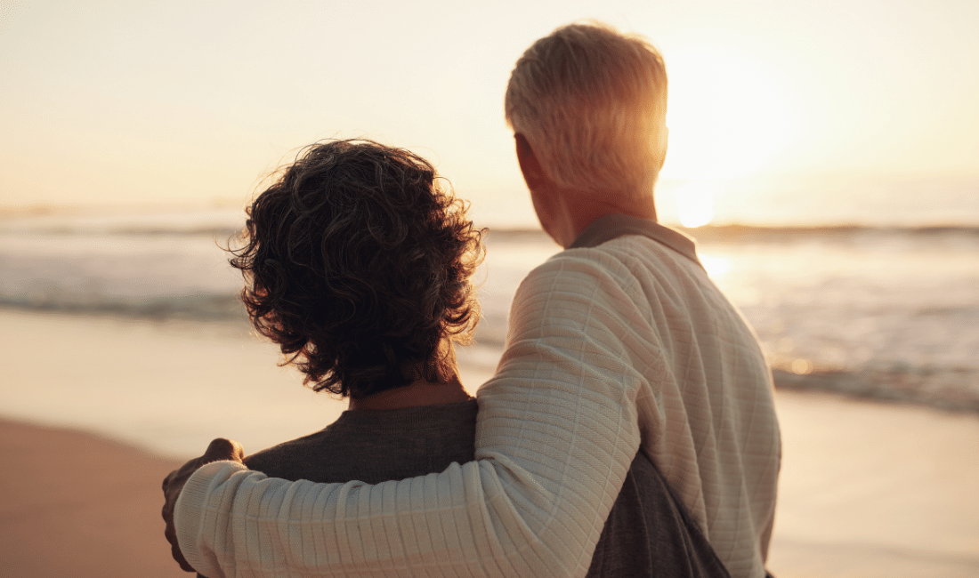 Old couple watching the sunset.