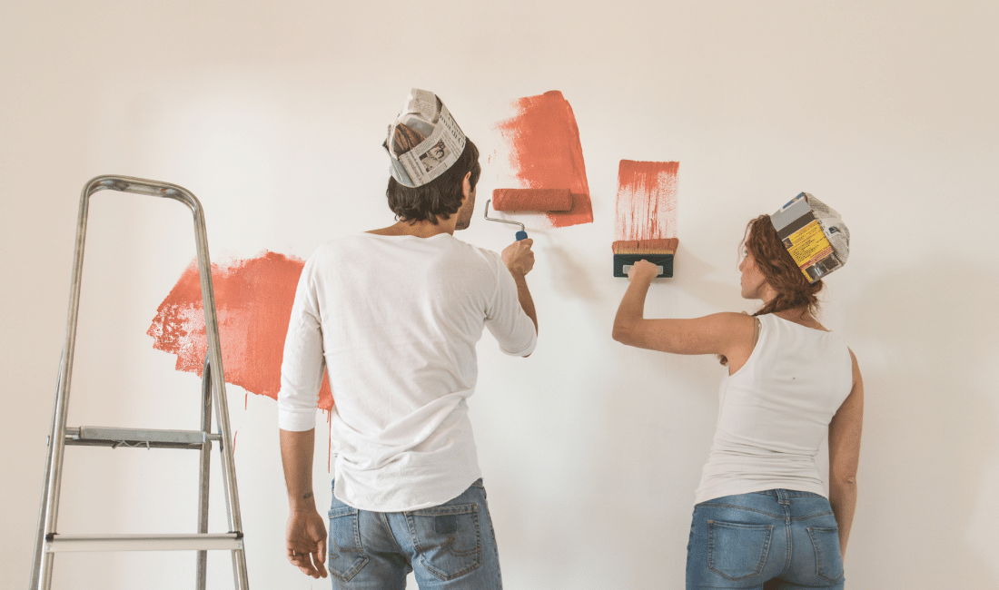 Couple painting their new house.