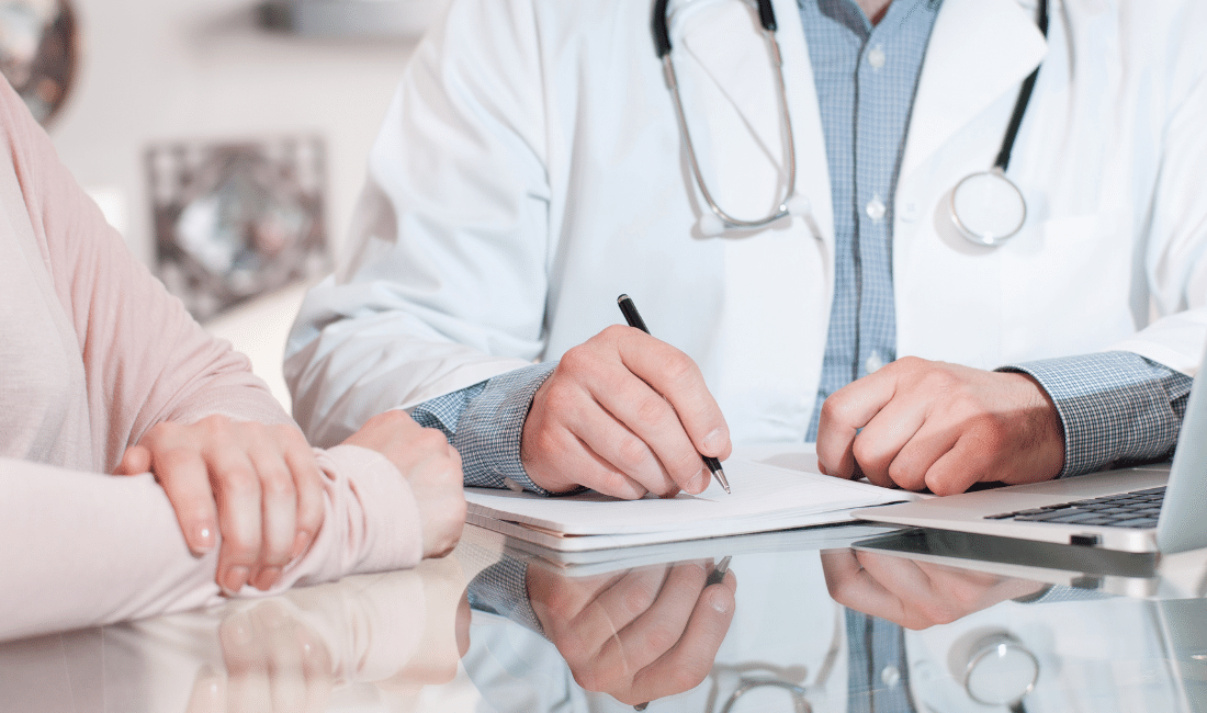 Doctor writing something down on a paper