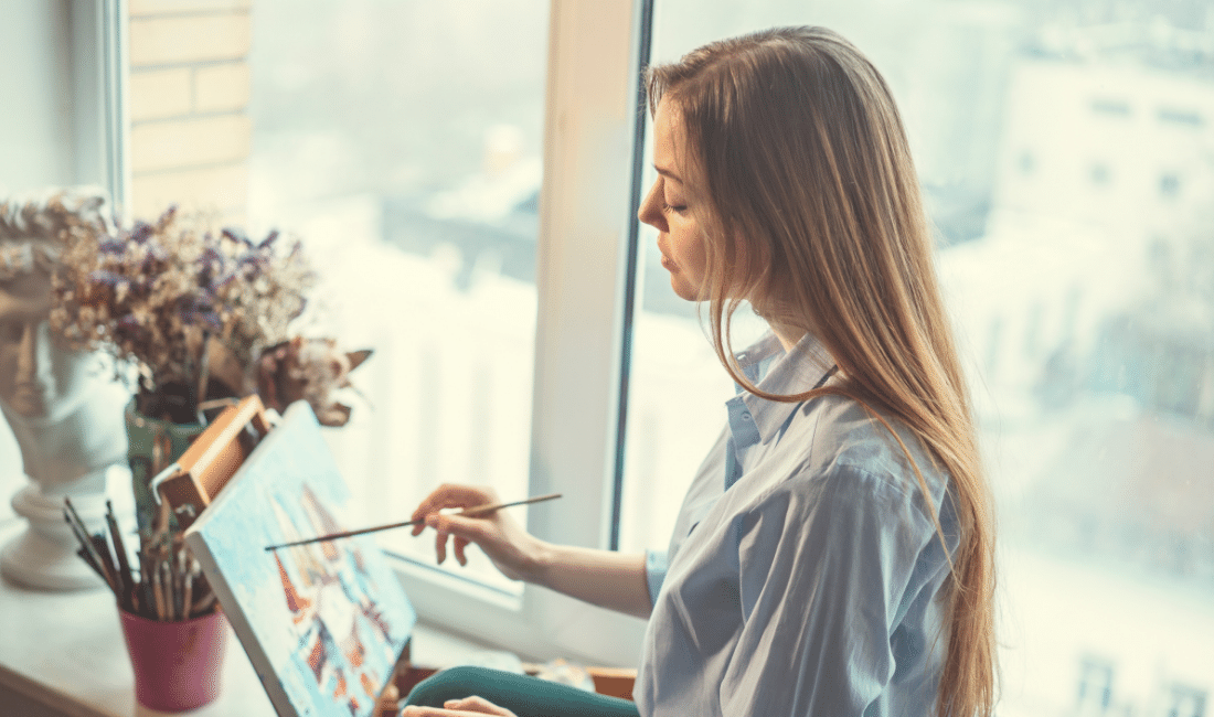 A lady painting in her room