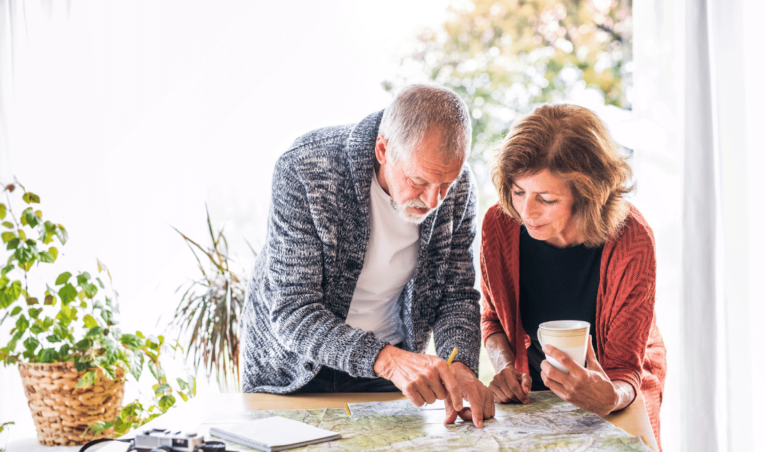 Senior Couple with Map at Home