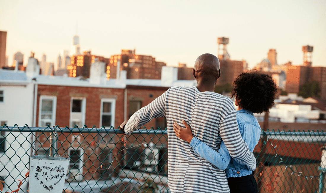 Young Black Couple on Rooftop.