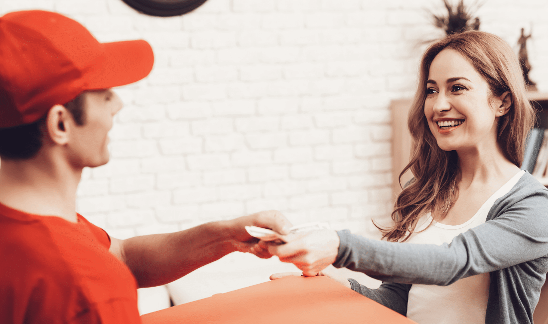 Smiling Woman Hands Money Pizza Delivery Man