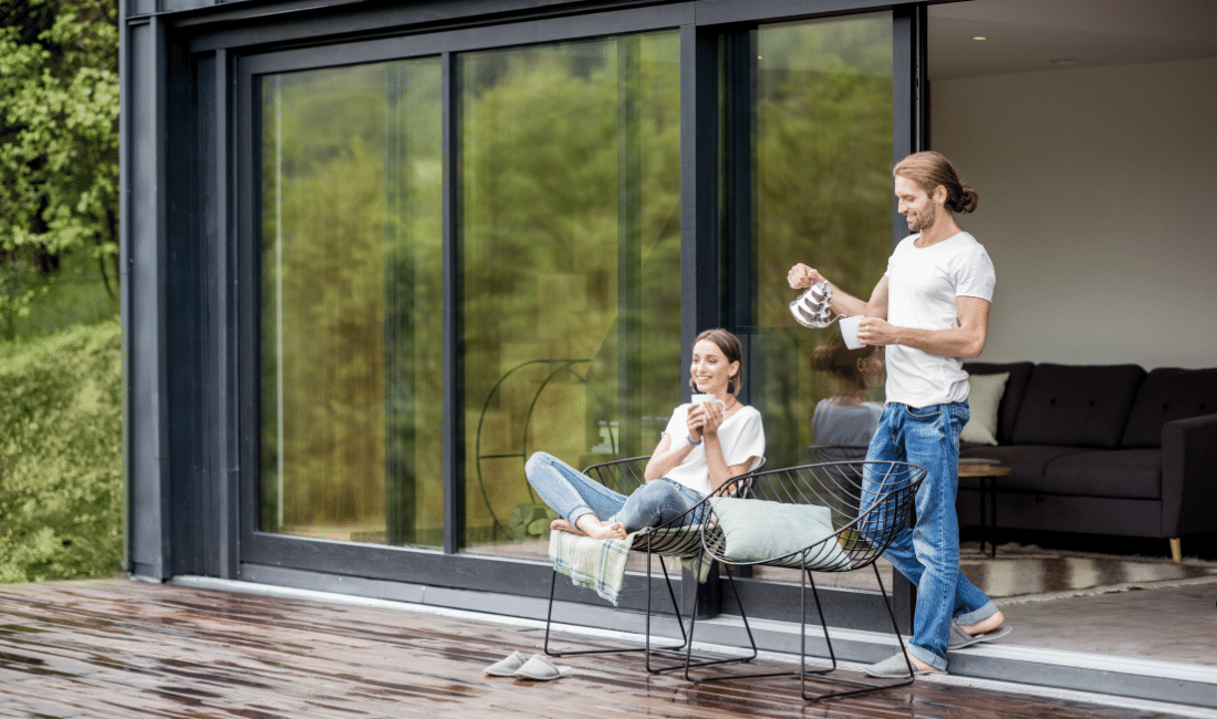Couple on the terrace of their new mortgaged house