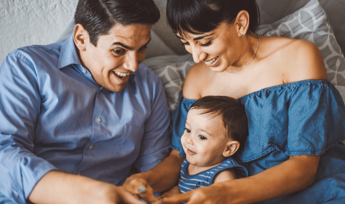 Happy family playing with their son after buying life insurance.