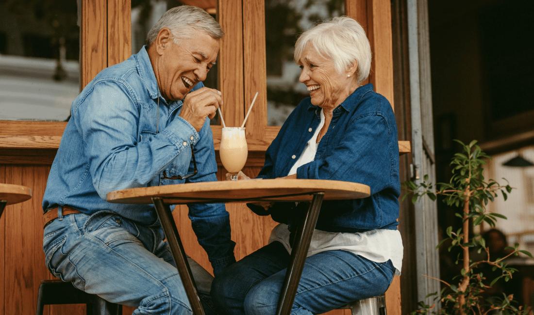 Senior Couple Having great time at Cafe. Single vs. Joint Life Insurance.