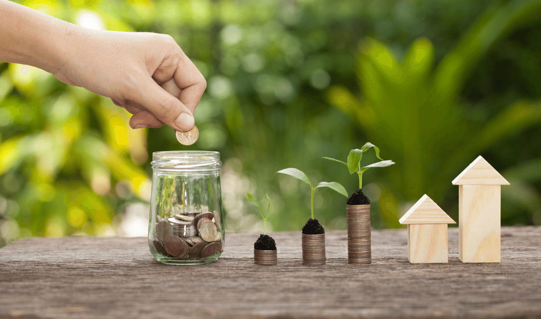 Hand putting money in a jar to save. Single vs. Joint Life Insurance.