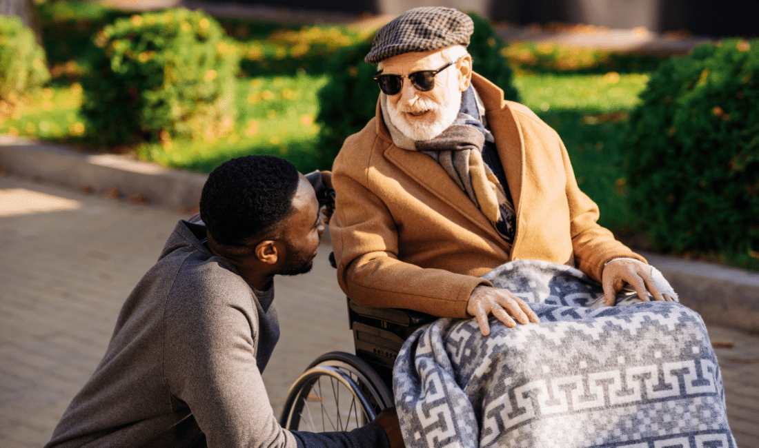 senior disabled man in wheelchair and african american nurse