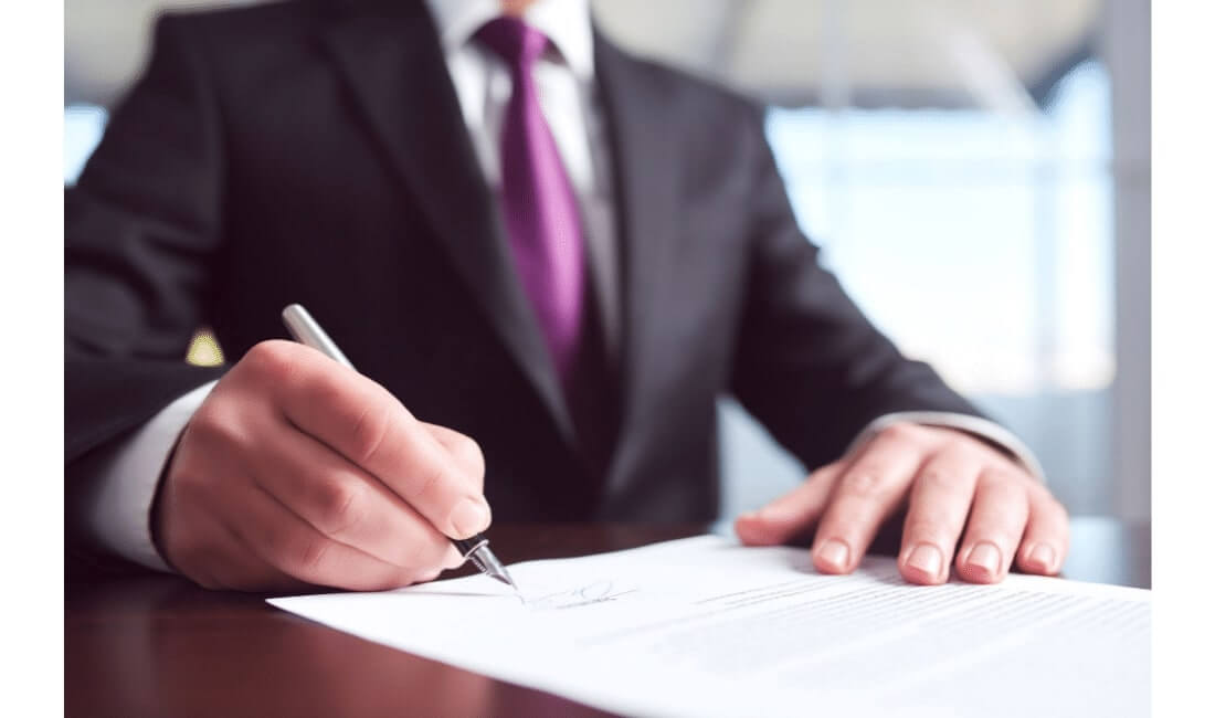 Man signing a life insurance form
