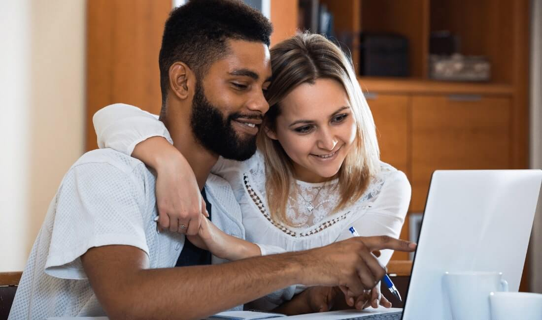 Couple doing research on laptop