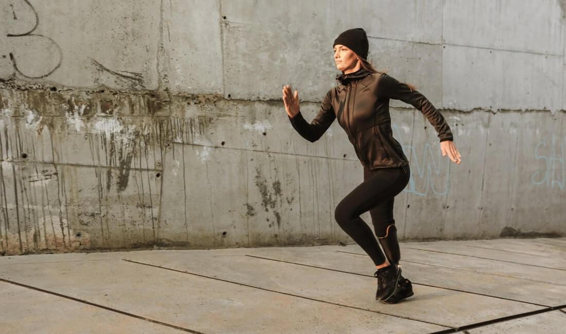 Woman with prosthetic leg jogging
