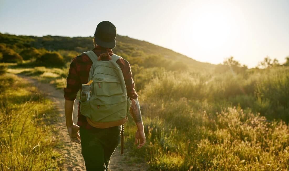 Male Millennial Hiker Walking Trail