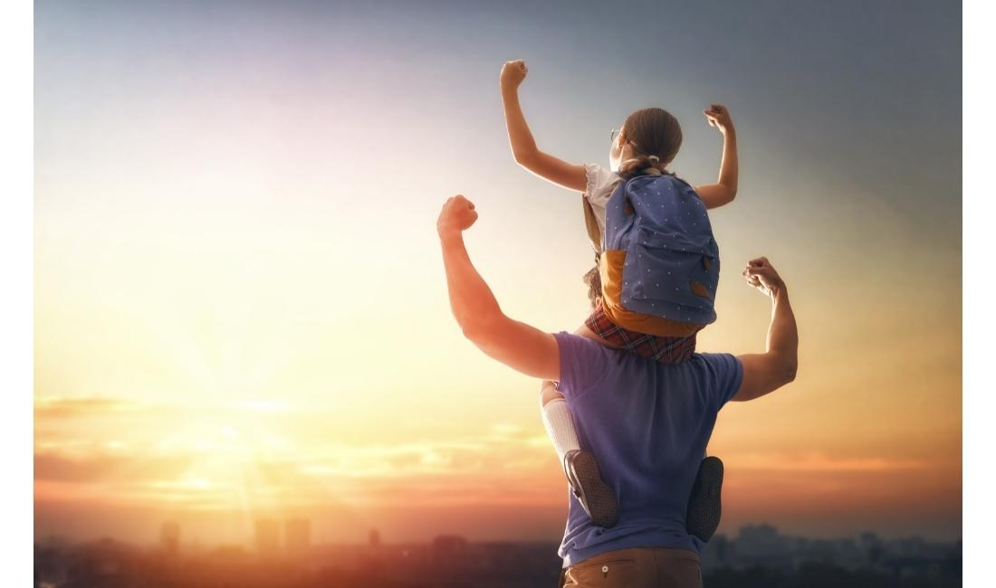 Father with child on his back