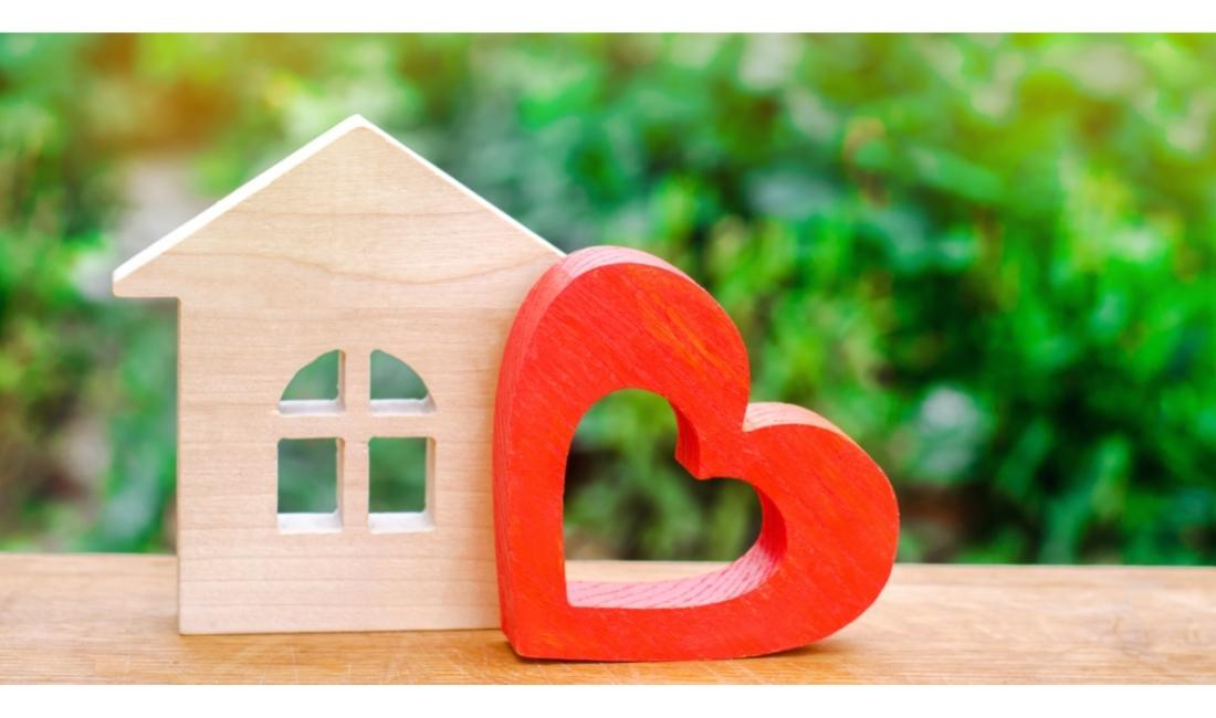 Wooden house and red heart